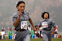 Female competitors dressed in revolutionary outfits race in the 'Spinning Wheel in Ya'nan' event of the Red Games. Held in Junan County, this sporting event is a nostalgic tribute to the communist era.