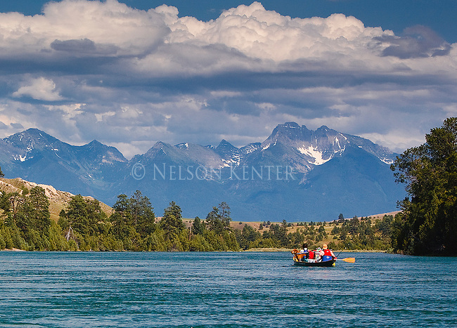Canoe on the Flathead River in Montana looking at the Mission Mountain Range above Dixon, Montana