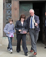 Pictured: Sonia Oatley (C) mother of tragic teen Rebecca Aylward with her young son Jack (L) is escorted by Ian Griffiths of South Wales Police (R) to the gathered media outside Swansea Crown Court. Friday 02 September 2011<br />