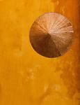 Ochre Wall Conical Hat - Traditional conical hat on an ochre wall, Hoi An, Viet Nam.