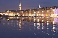 Tower and church Eglise Saint Michel. On Les Quais. Place de la Bourse. The new fountain Miroir d'Eau, Water Mirror, making reflections. Bordeaux city, Aquitaine, Gironde, France
