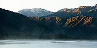 Sunrise over mountains at Lake Kaniere, West Coast, South Westland, South Island, New Zealand, NZ