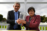 Trainer David Evans receives his trophy from sponsors  after winning The Bathwick Tyres Conditions Stakes  during Afternoon Racing at Salisbury Racecourse on 4th October 2017