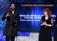 "Karim Sulayman, left, and Jeannette Sorrell accept the award for best classical solo vocal album for ""Songs of Orpheus: Monteverdi, Caccini, d'India, Landi"" at the 61st annual Grammy Awards on Sunday, Feb. 10, 2019, in Los Angeles. (Photo by Matt Sayles/Invision/AP)"