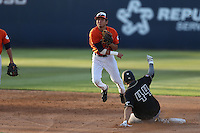 Josh Vargas (40) of the Cal State Fullerton Titans throws to first base after forcing out Tommy Pluschkell (44) of the Cal Poly Mustangs at second base during a game at Goodwin Field on April 2, 2015 in Fullerton, California. Cal Poly defeated Cal State Fullerton, 5-0. (Larry Goren/Four Seam Images)