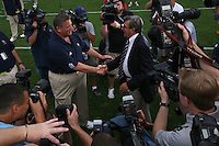 State College, PA -- 09/8/2007 -- Notre Dame head coach Charlie Weis (left) greets Penn State head coach Joe Paterno (left) amid a group of photographers before the game at Beaver Stadium on Saturday, September 8, 2007.  Penn State defeated Notre Dame by a score of 31-10.    ..Photo:  Joe Rokita / JoeRokita.com