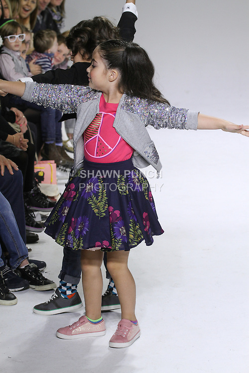 Young model walks runway in the Clarks Spring Summer 2015 kids footwear collection, at petitePARADE Spring Summer 2015, during Kids Fashion Week in New York City, on October 19, 2014.