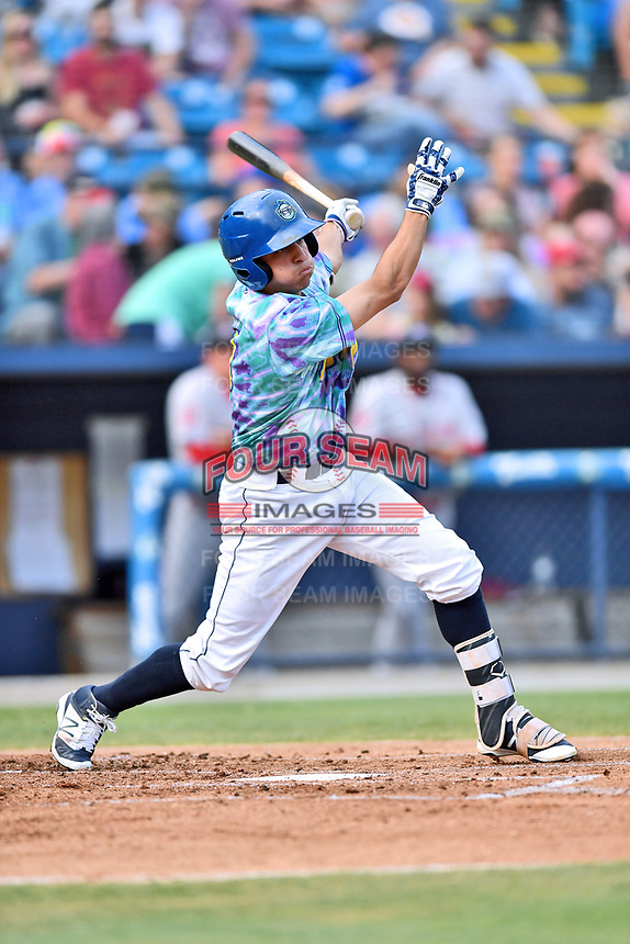 Asheville Hippies third baseman Jose Gomez (4) swings at a pitch during a game against the Greenville Drive at McCormick Field on June 29, 2017 in Asheville, North Carolina. The Drive defeated the Tourists 9-6. (Tony Farlow/Four Seam Images)