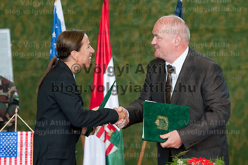Eleni Tsakopoulos Kounalakis (L) ambassador for the United States of America and Csaba Hende (R) Defence Minister for Hungary sign aggreements during the presentation of the Coalition Support Fund for Hungary by the US military in Szolnok, Hungary on July 18, 2011. ATTILA VOLGYI