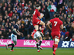 Dan Biggar of Wales is tackled midair by Finn Russell of Scotland which led to Russell being sin binned - RBS 6Nations 2015 - Scotland  vs Wales - BT Murrayfield Stadium - Edinburgh - Scotland - 15th February 2015 - Picture Simon Bellis/Sportimage