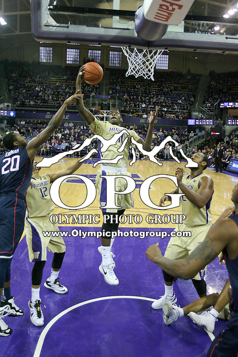 December 22, 2013:  Washington's Mike Anderson drives to the basket against Connecticut.  Connecticut defeated Washington 82-70 at Alaska Airlines Arena Seattle, Washington.
