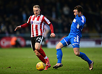 Lincoln City's Danny Rowe vies for possession with Notts County's Matt Tootle<br /> <br /> Photographer Chris Vaughan/CameraSport<br /> <br /> The EFL Sky Bet League Two - Lincoln City v Notts County - Saturday 13th January 2018 - Sincil Bank - Lincoln<br /> <br /> World Copyright &copy; 2018 CameraSport. All rights reserved. 43 Linden Ave. Countesthorpe. Leicester. England. LE8 5PG - Tel: +44 (0) 116 277 4147 - admin@camerasport.com - www.camerasport.com