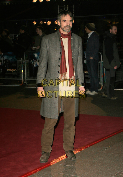"""JEREMY IRONS .Arrivals - """"Eragon"""" World Premiere, .Odeon Leicester Square, London, .England, December 11th 2006..full length red scarf green coat brown trousers .CAP/AH.©Adam Houghton/Capital Pictures"""
