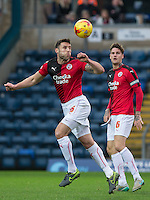 Jon Ashton of Crawley Town clears the ball during the Sky Bet League 2 match between Wycombe Wanderers and Crawley Town at Adams Park, High Wycombe, England on 28 December 2015. Photo by Andy Rowland / PRiME Media Images