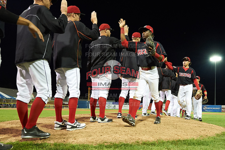 Batavia Muckdogs Anfernee Seymour (3) goes through the high five line after a win against the Mahoning Valley Scrappers on July 3, 2015 at Dwyer Stadium in Batavia, New York.  Batavia defeated Mahoning Valley 7-4.  (Mike Janes/Four Seam Images)