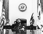 White House Photographer Ron Bennett in Vice Presidents office,