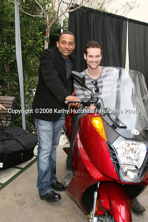 Hill Harper & Shane West.discussing the 100% electric motorcycle by Vetrix.GBK Productions Oscar Gifting Suite.Boulevard3.Los Angeles, CA.February 22, 2008.©2008 Kathy Hutchins / Hutchins Photo....