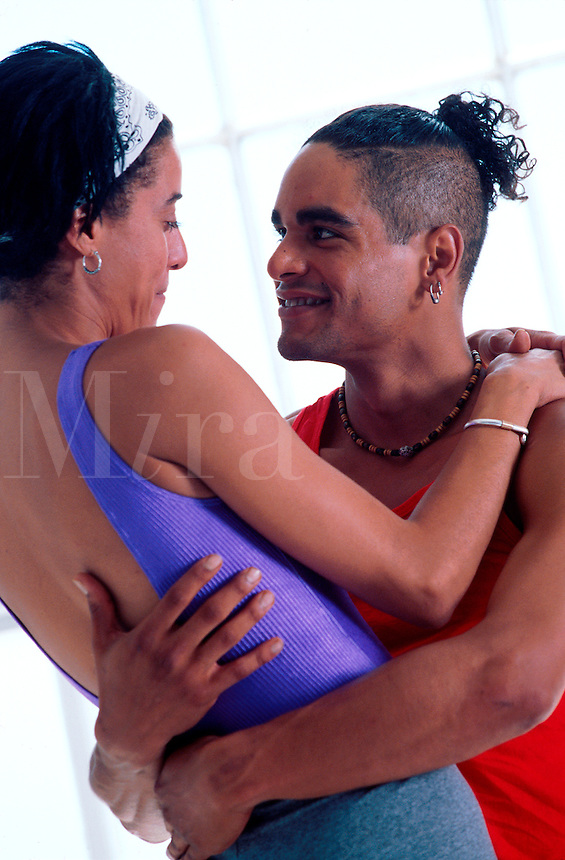 Couple in affectionate and playful embrace after workout.