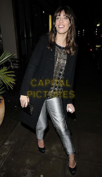 Laura Jackson.attended the Casio Tokyo Trio Watch launch party, The Study, Blandford St., London, England..January 28th, 2013.full length black jacket coat gold silver trousers clutch bag  .CAP/CAN.©Can Nguyen/Capital Pictures.