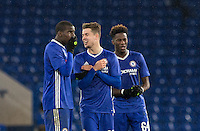 Kurt Zouma of Chelsea and Marco Van Ginkel of chelsea joke as the penalties continue during the The Checkatrade Trophy match between Chelsea U23 and Oxford United at Stamford Bridge, London, England on 8 November 2016. Photo by Andy Rowland.