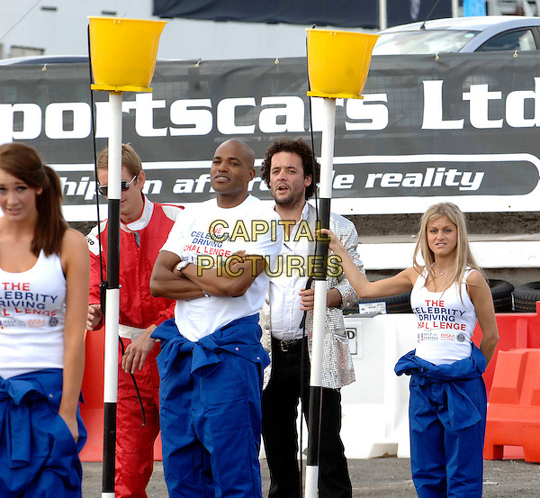 PETA TODD, DU'AINE THORNE-LADEJO & NIKKI GRAHAME.The Celebrity Driving Challenge, ExCeL, London, England..July 23rd, 2008.half 3/4 length blue trousers jumpsuit white t-shirt arms crossed .CAP/WIZ.© Wizard/Capital Pictures.