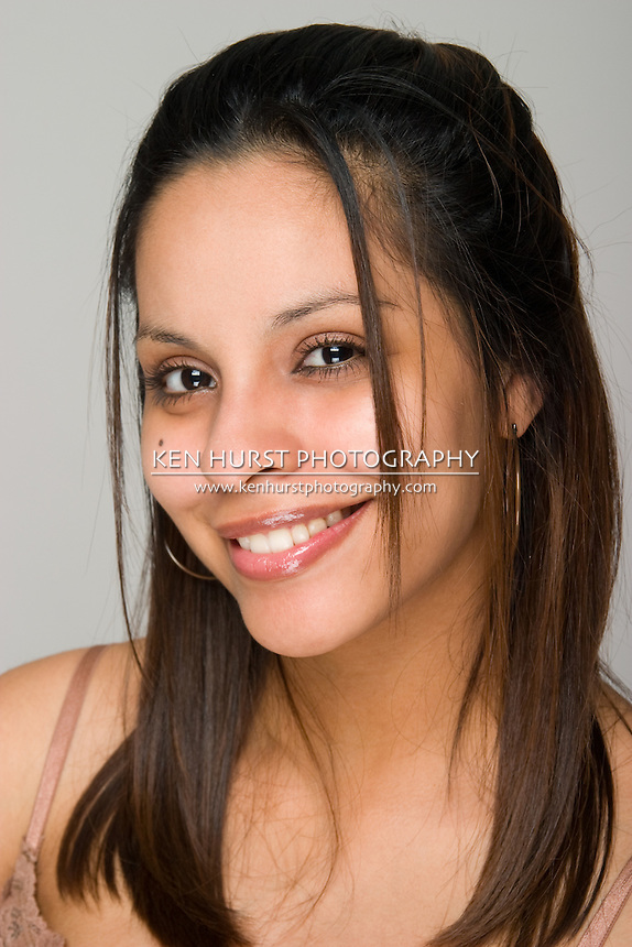 Head shot portrait of a young beautiful Hispanic woman. Limited depth-of-field with focus on model eye nearest the camera.