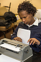 South Africa, Cape Town.  Young Student Typing on a Perkins Brailler.  Athlone School for the Blind.