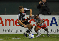 Toronto FC midfielder Marvell Wynne (16) fights for possession of the ball against DC United defender Greg Vanney (6). DC United defeated Toronto FC 4-1, at RFK Stadium in Washington DC, on Saturday September 29, 2007.