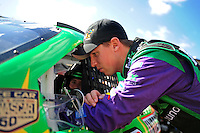 Sept. 19, 2008; Dover, DE, USA; Nascar Sprint Cup Series driver Denny Hamlin talks with teammate Kyle Busch during practice for the Camping World RV 400 at Dover International Speedway. Mandatory Credit: Mark J. Rebilas-
