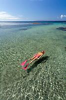 A woman snorkels at Olowalu, Maui.