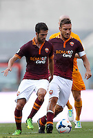 Calcio, Serie A: Roma vs Hellas Verona. Roma, stadio Olimpico, 1 settembre 2013.<br /> AS Roma midfielder Miralem Pjanic, of Bosnia, and forward Francesco Totti, right, go for the ball during the Italian Serie A football match between AS Roma and Hellas Verona at Rome's Olympic stadium, 1 September 2013.<br /> UPDATE IMAGES PRESS/Isabella Bonotto