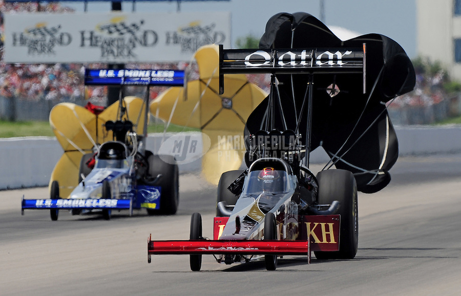 May 31, 2009; Topeka, KS, USA: NHRA top fuel driver Larry Dixon (right) after defeating Spencer Massey during the semi finals of eliminations in the Summer Nationals at Heartland Park Topeka. Mandatory Credit: Mark J. Rebilas-