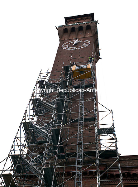 Waterbury, CT- 12 January 2016-011216CM01- Workers remove some of the scaffolding at the Republican-American tower in Waterbury on Tuesday.  Crews were removing part of the a temporary structure as they continued work on the tower, which was also the city's former Union Station, built in 1909.  It was designed by the renowned architectural firm of McKim, Mead and White.      Christopher Massa Republican-American