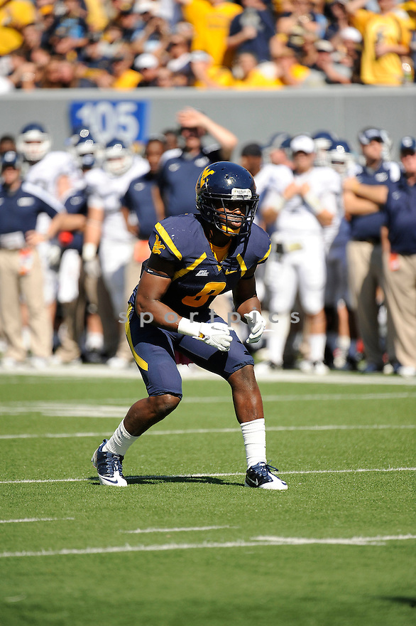 KEITH TANDY, of the West Virginia Mountaineers, in action during West Virginia's game against the UConn Huskies on October 8, 2011 at Milan Puskar Stadium in Morgantown, WV. West Virginia beat UConn 43-16.