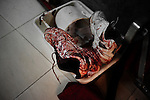 ALEPPO: August 3rd 2012:..A pair of bloody trainers lay at the entrance of a field hospital in Aleppo..Ayman Oghanna for The Sunday Telegraph.