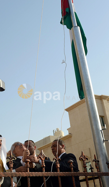 Palestinian President Mahmoud Abbas raises the Palestinian flag during the ceremony of inaugurate the Palestinian embassy in Kuwait on April 15, 2013. Abbas re-opened the Palestinian embassy in Kuwait since 22 years after it was shut down. Photo by Thaer Ganaim