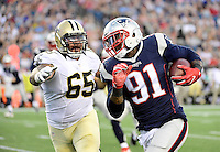 Thursday August 11, 2016: New England Patriots outside linebacker Jamie Collins (91) keeps free of New Orleans Saints guard Senio Kelemete (65) and runs back his interception for a touchdown during an NFL pre-season game between the New Orleans Saints and the New England Patriots held at Gillette Stadium in Foxborough Massachusetts. The Patriots defeat the Saints 34-22 in regulation time. Eric Canha/CSM