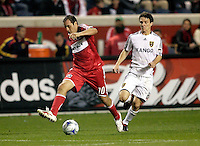 Chicago Fire midfielder Cuauhtemoc Blanco (10) makes a back heel pass in front of Real Salt Lake midfielder Will Johnson (8).  Real Salt Lake defeated the Chicago Fire in a penalty kick shootout 0-0 (5-4 PK) in the Eastern Conference Final at Toyota Park in Bridgeview, IL on November 14, 2009.