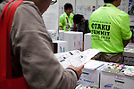 "Visitors read manga books at the Niconico Douga fan event at Makuhari Messe International Exhibition Hall on April 25, 2015, Chiba, Japan. The event includes special attractions such as J-pop concerts, Sumo and Pro Wrestling matches, cosplay and manga and various robot performances and is broadcast live on via the video-sharing site. Niconico Douga (in English ""Smiley, Smiley Video"") is one of Japan's biggest video community sites where users can upload, view, share videos and write comments directly in real time, creating a sense of a shared watching. According to the organizers more than 200,000 viewers for two days will see the event by internet. The popular event is held in all 11 halls of the huge Makuhari Messe exhibition center from April 25 to 26. (Photo by Rodrigo Reyes Marin/AFLO)"