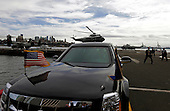 Marine One carrying United States President Barack Obama from John F. Kennedy airport to lower Manhattan lands behind the Presidential Limousine, nicknamed the 'beast' in New York, New York, USA, 27 September 2015.  The President will speak at the Sustainable Development Summit today and address the the 70th session of the United Nations General Assembly, General Debate on Monday 28 September 2015. <br /> Credit: Peter Foley / Pool via CNP