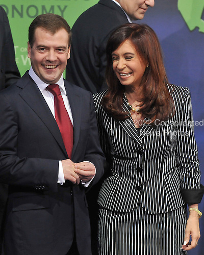 Washington, D.C. - November 15, 2008 -- President Dmitry A. Medvedev of Russia, left, and President Cristina Fernandez de Kirchner of Argentina, right, share a laugh as they posed for a class photo with other world leaders at the Summit on Financial Markets and the World Economy at the National Building Museum in Washington, D.C. on Saturday, November 15, 2008. .Credit: Ron Sachs / Pool via CNP