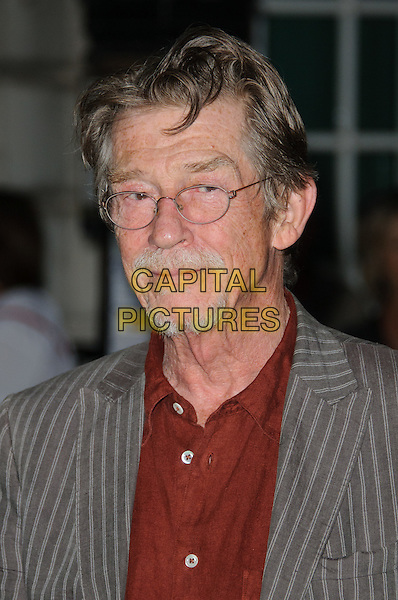 John Hurt.UK Premiere of 'Melancholia' at the Curzon, Mayfair, London, England..September 28th 2011.headshot portrait grey gray pinstripe suit jacket red shirt glasses goatee facial hair.CAP/CJ.©Chris Joseph/Capital Pictures.