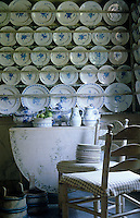 Rows of blue and white plates are displayed on wall-to-wall plate racks in the china pantry