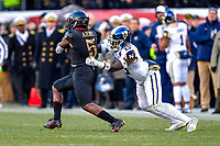 PHILADELPHIA, PA - DEC 8, 2018: Army Black Knights running back Kell Walker (5) is tackled by Navy Midshipmen safety Juan Hailey (13) during game between Army and Navy at Lincoln Financial Field in Philadelphia, PA. Army defeated Navy 17-10 to win the Commander in Chief Cup. (Photo by Phil Peters/Media Images International)