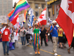 Out of focus photo of participants of Gay and lesbian Pride parade in Toronto Ontario Canada 2009