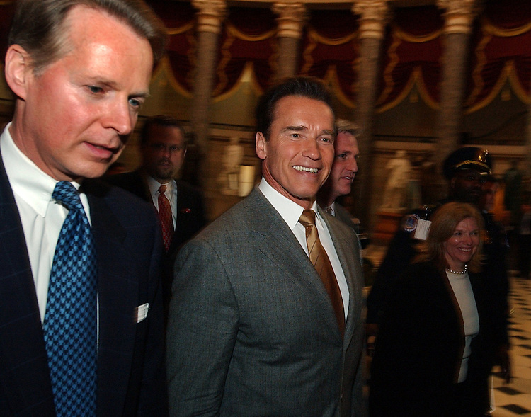 Gov. Arnold Schwarzenegger, R-Calif., walks through Statuary Hall with Rep. David Dreier, R-Calif., Thrusday.