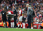 9th September 2017, Emirates Stadium, London, England; EPL Premier League Football, Arsenal versus Bournemouth; Alexis Sanchez of Arsenal and Arsenal manager Arsene Wenger both look on from the touchline