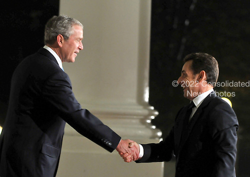 Washington, D.C. - November 14, 2008 -- United States President George W. Bush welcomes President  Nicolas Sarkozy of France to the Summit on Financial Markets and the World Economy on the North Portico of the White House in Washington, D.C. on Friday, November 14, 2008..Credit: Ron Sachs / Pool via CNP