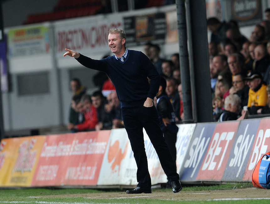 Newport County manager John Sheridan  shouts instructions from the technical area<br /> <br /> Photographer  Ian Cook/CameraSport<br /> <br /> Football - The Football League Sky Bet League Two - Newport County AFC v Exeter City - Saturday 3rd October 2015 - Rodney Parade - Newport<br /> <br /> &copy; CameraSport - 43 Linden Ave. Countesthorpe. Leicester. England. LE8 5PG - Tel: +44 (0) 116 277 4147 - admin@camerasport.com - www.camerasport.com