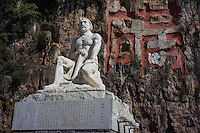 "A statue is seen outside a tin mine in Gejiu, November 2014. Gejiu in Yunnan province is a ""Tin Centre"" with more than 2,000 years of mining history. Tin articles made in Gejiu are highly acclaimed in China. However, the tin mining and related industries are in decline."